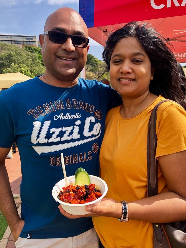 MORE-ISH: Mark and Tamara Naidoo get stuck into some of the Crazy Korean's gangjong sticky chicken.